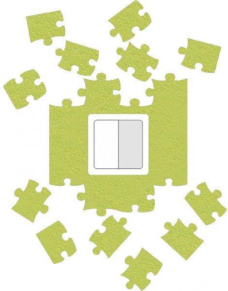 Ochrana zdi kolem vypínače nebo zásuvky Puzzle zelené