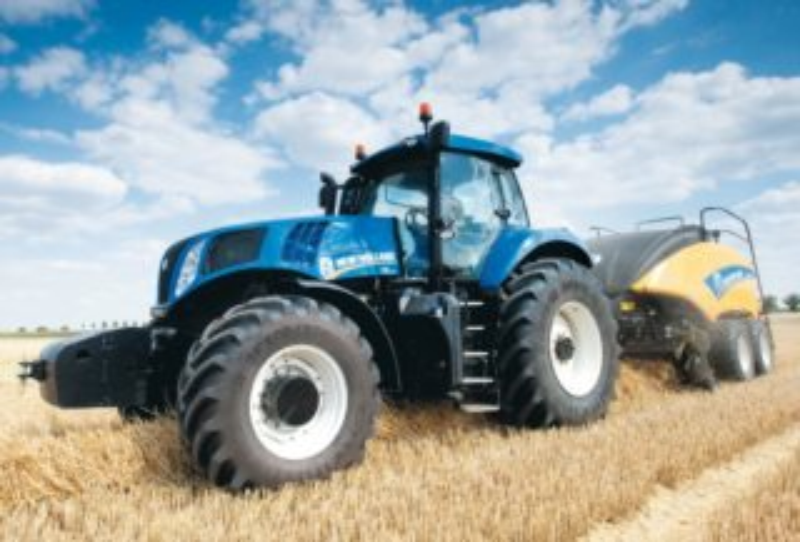 SCHMIDT Puzzle Traktor New Holland 1290 s lisem na balíky 100 dílků